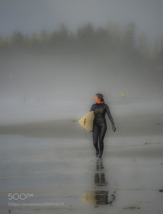 tofino winter storm surfer - Winter storms in Tofino can be a surfers dream. Here the fog was so thick it could disorient you but the surfers kept on going out to sea!