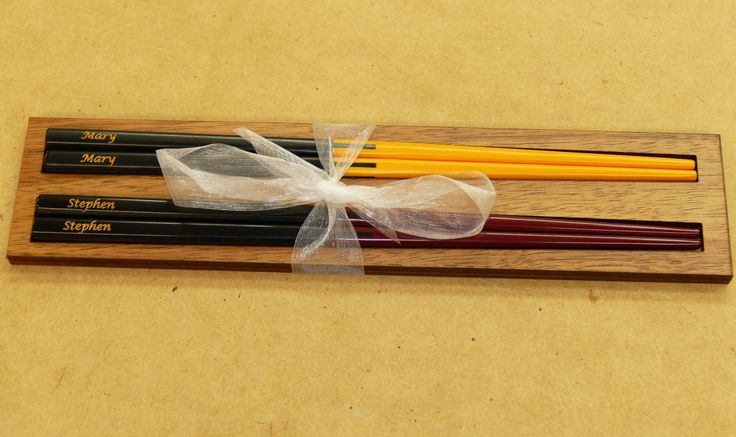 Chopsticks engraved or printed. Example two tone melamine in wooden display gift pack.