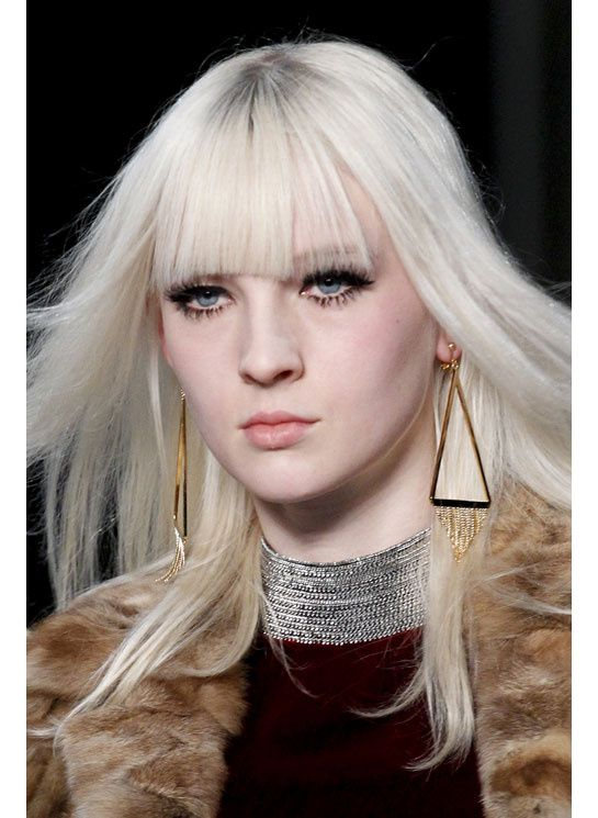 Geometrics, especially triangles, are indentified to be taking off in the world of fashion and style from home decor to accessories, as seen here with these gold triangle earrings. 2014-2015
