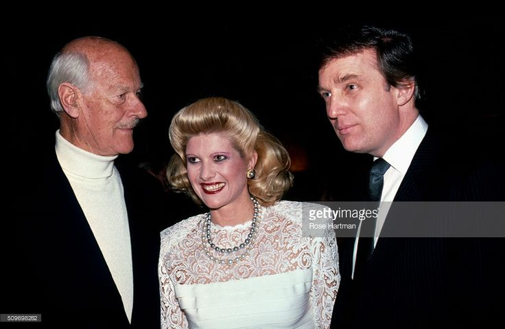 Portrait of, from left, British photographer Norman Parkinson (1913 - 1990), Ivana (nee Zelnickova) Trump, and American businessman Donald Trump as they attend a private party (in the apartment of Henry Kravis), New York, New York, 1978.