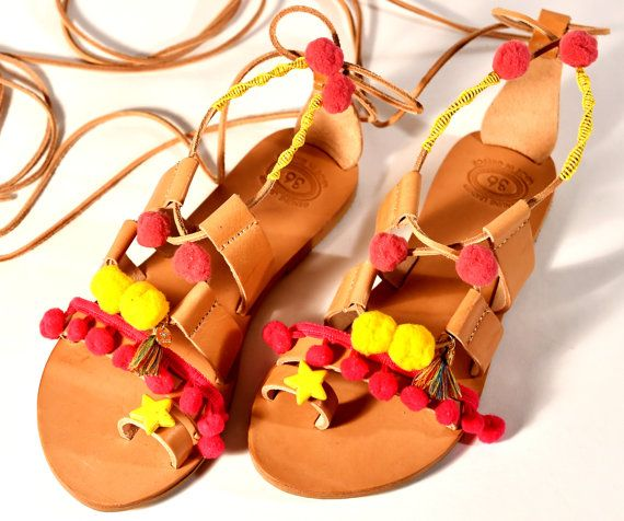 Handmade Boho leather sandals decorated with pom pom. by Frabala