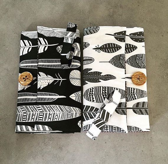 This beautifully designed nappy change set // nappy wallet // nappy clutch // travel change mat features a built-in change mat and has 3 practical