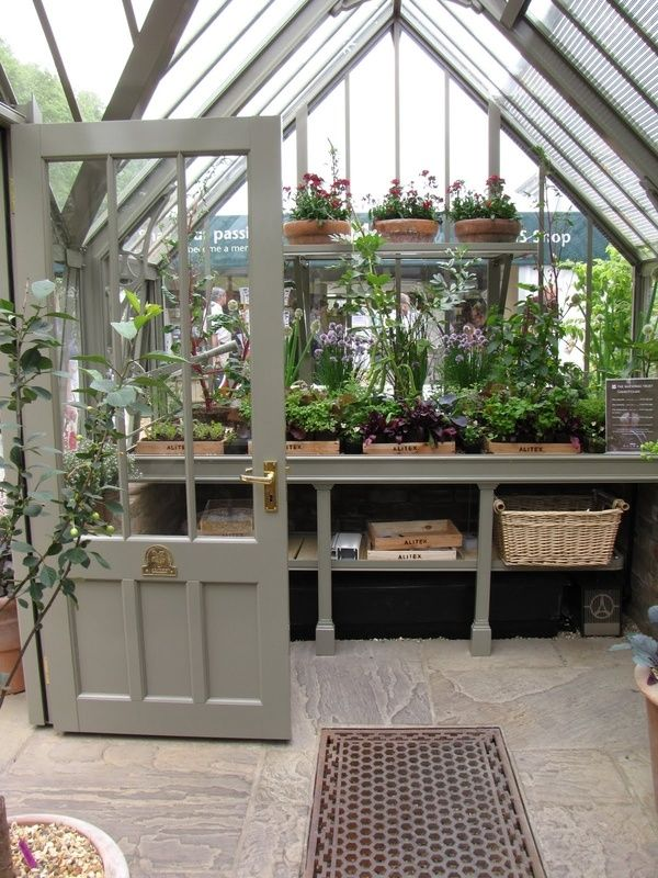 one day maybe i will have my own green house indoor garden love love love this greenhouse good idea keep plants together on wooden trays labeled with