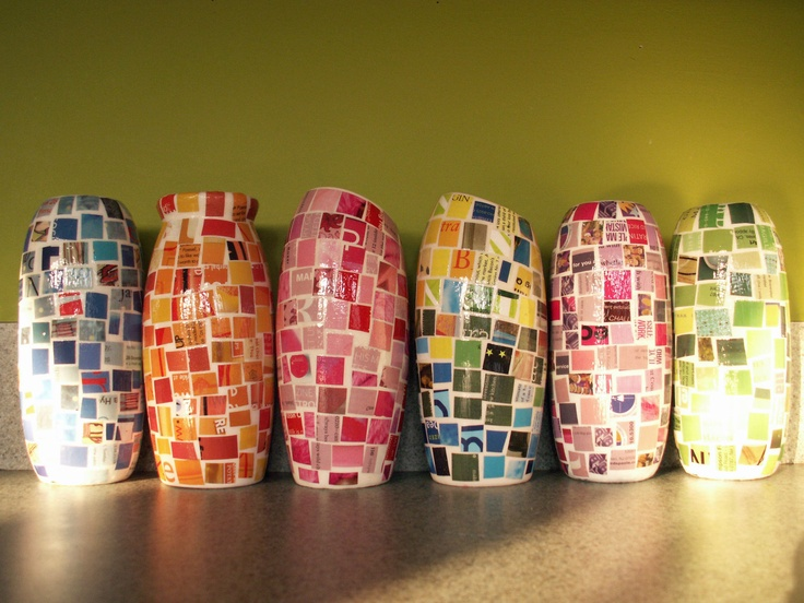 """Recycled magazine paper + modpodge """"mosaics"""" on recycled plastic bottles (it looks like). Cute little vases or pencil  pen holders!"""