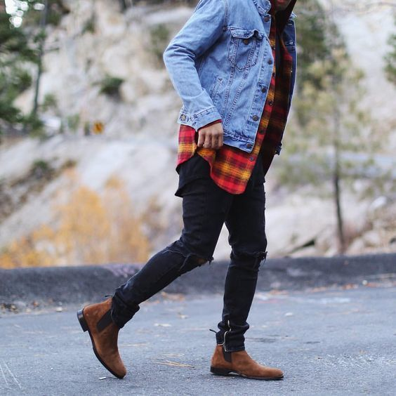 Reach for a light blue jacket and black ripped skinny jeans to effortlessly deal with whatever this day throws at you. Smarten up your outfit with brown suede chelsea boots.   Shop this look on Lookastic: https://lookastic.com/men/looks/denim-jacket-long-sleeve-shirt-crew-neck-t-shirt/22760   — Light Blue Denim Jacket  — Red Check Long Sleeve Shirt  — Black Crew-neck T-shirt  — Black Ripped Skinny Jeans  — Brown Suede Chelsea Boots