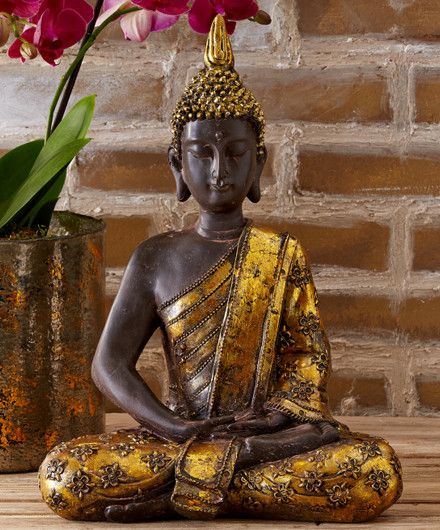 Burnished resin and brushed gold combine to create this serene and gorgeously detailed meditating Buddha statue from Tozai Home. Veiled with an expression of deep meditative reverie, this Buddha is be