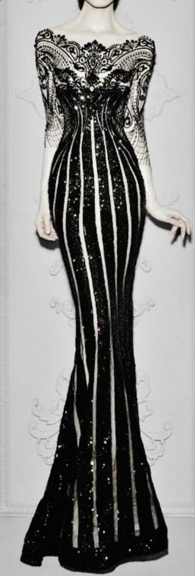 Whoa....! What?! Stunning dress- model looks 7 ft tall