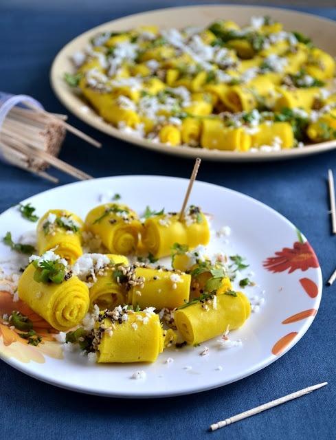 Gujarathi Farsan - Khandvi, GayathrisCookSpot (besan, sour curd, sugar, turmeric, oil, sesame and mustard seeds, asafoetida, curry leaves, green chili, grated coconut, cilantro)