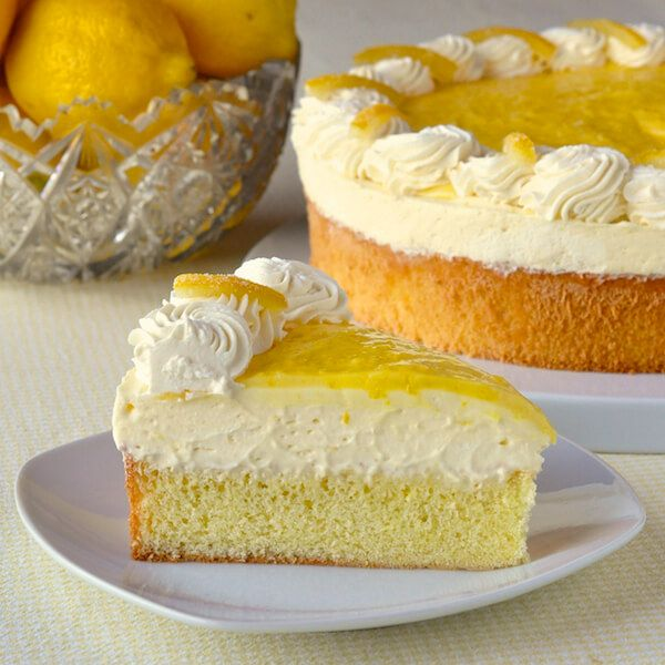 Lemon Mousse Cake. An easy version of lemon mousse comprised of lemon curd and whipped cream sits atop a light-as-air sponge cake and is then topped with more lemon curd, whipped cream and candied lemon peel.