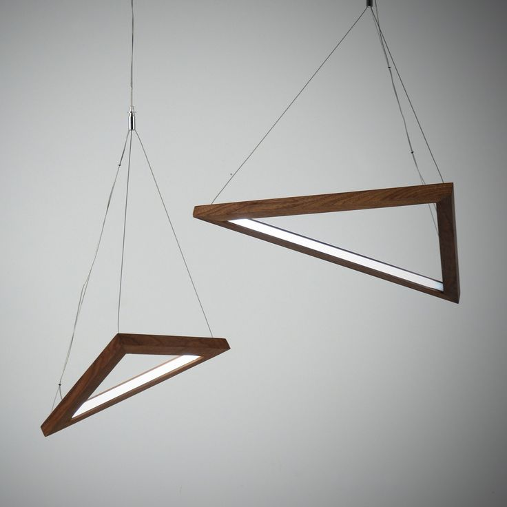 Highlighting the beauty of simple geometry, the Triangle LED Pendant Light features a 24V LED extrusion in a solid wood design.