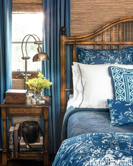 """For a guest bedroom, a Queen Malacca bamboo bed by Baker and Phillip Jeffries's grass cloth wallcovering """"evoke the British Colonial tropics,"""" designer David Dalton says."""