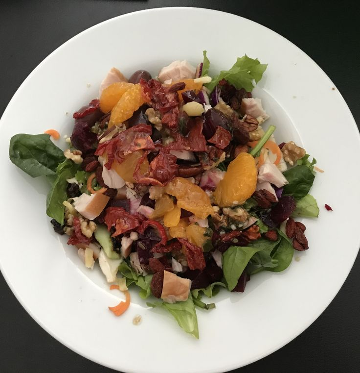 Lettuce salad with l, olives, cranberries, smoked chicken, walnuts, mandarin segments, beetroot, pecans. Dressing of tomato oil, balsamic, tube basil and minced garlic.