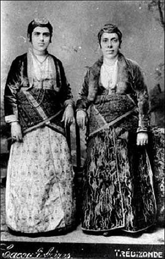 Traditional festive costumes of the 'Rum' (Greek-Orthodox)inhabitants from Trebizonde/Trabzon (eastern Black Sea coast).  Late-Ottoman era, urban style, early 20th century.
