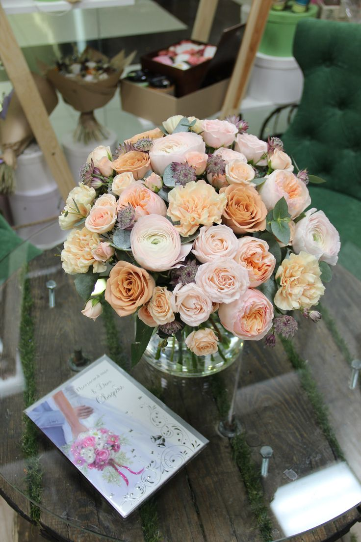 the bride's bouquet. wedding. Wedding floristry. Ranunculus, Pion-shaped Roses, Astratia, Rose Cappuccino, Rose Juliet, Rose Bombastique