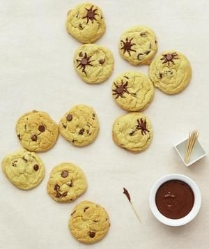 Spider Cookies With Chocolate Chips: To recreate the look, dip a toothpick in melted chocolate and draw legs around an exposed chip—or two.