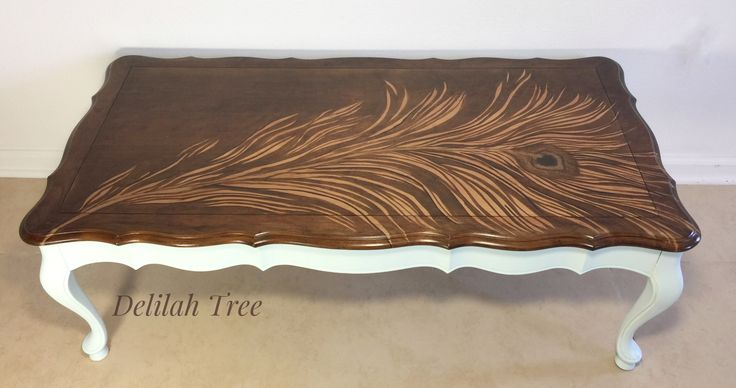 Peacock feather stain art on antique French Provincial coffee table by Delilah Tree.