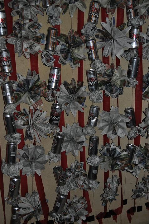 """Amazing garland for a white trash party! Would have been more """"white trash"""" using National Enquirers and Pabst Blue Ribbon, Lone Star or Keystone cans!"""
