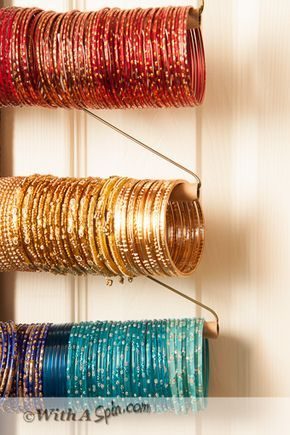 Take control of your clutter. Re-purpose hangers to organize bangles and bracelets and hang on the door. Save closet space.
