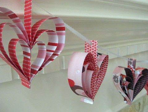 Use strips of paper to create a heart shape and some colorful ribbon.  Then hang for a hearty fun decoration.