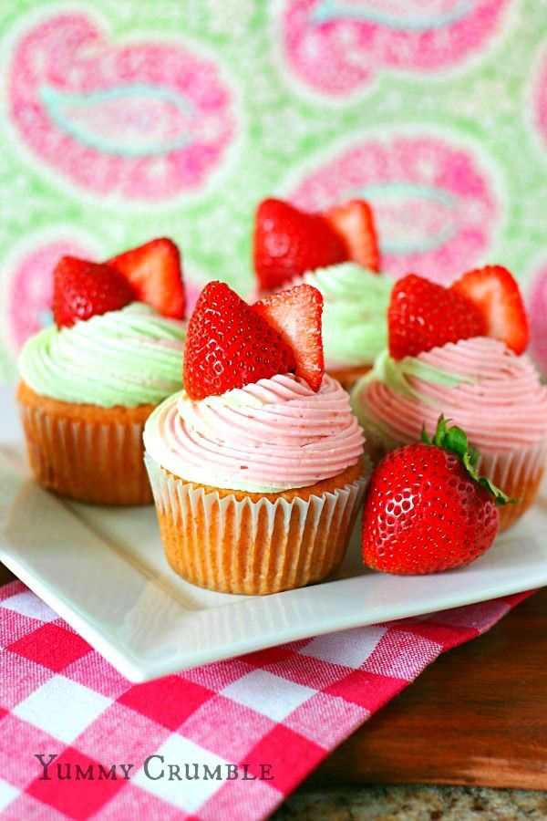 strawberry key lime cupcakes filled with key lime pie filling and topped with strawberry and lime buttercream frosting