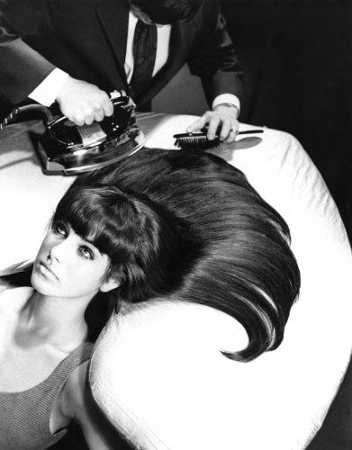 """1960s """"flat iron"""". Actually IRONED your hair to get it straight We did this at home on the ironing board with a towel covering your hair."""