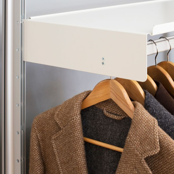 An unassuming wardrobe: SEH Kelly at Vitsœ London Manx and Portland sheep give their distinct colours to this undyed British lambswool jacket. It sits comfortably under our shelf with hanging rail thanks to the similar radii of SEH Kelly lapels and our furniture. www.vitsoe.com