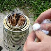 2-Can camping stove.  If you used a #10 can, I bet you could cook a bit more.