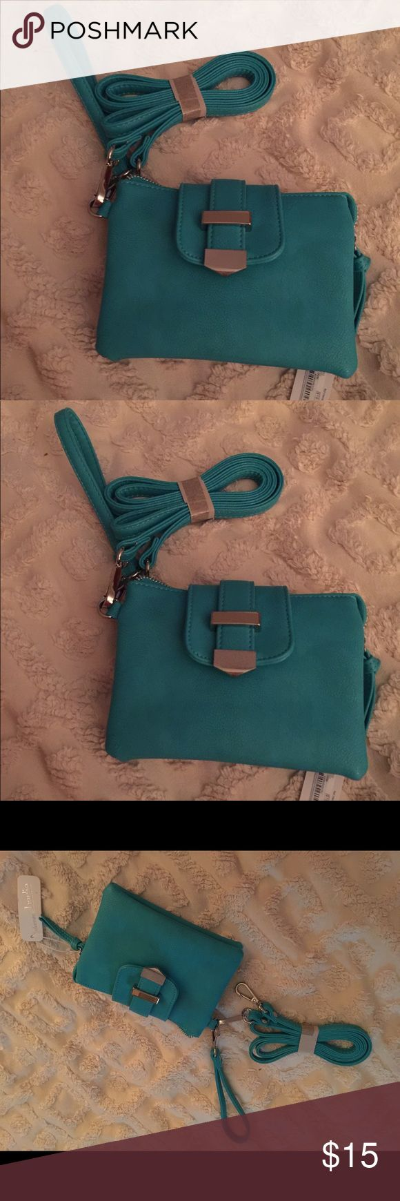Cute Crossbody wristlet Bag 7x5 Turquoise Charming Charlie's Crossbody/wristlet bag Beautiful Turquoise color. Charming Charlie Bags Crossbody Bags
