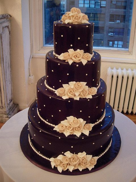 Beautiful and elegant, love the beige flowers against the dark chocolate surface