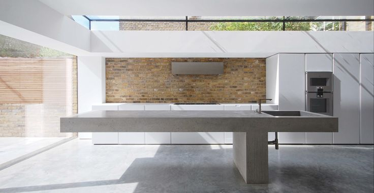 Completed earlier this year, this Lazenby cantilevered work top spanning over 3m is not only concrete furniture but a work of art. Cast in-situ over the previously installed Lazenby Polished Floor which leads out from the kitchen on to the patio.