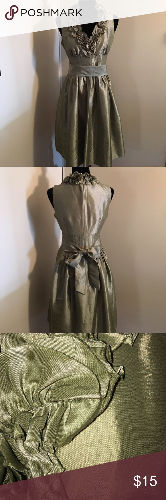 Beautiful cocktail dress This dress would be great for just about any cocktail event. Especially with the holiday coming. Sz 6. Fully lined. Hidden back zipper and hook eye at neck. 50% polyester 50% nylon. Color is a sage green shown best in last photo. London Times Dresses Wedding