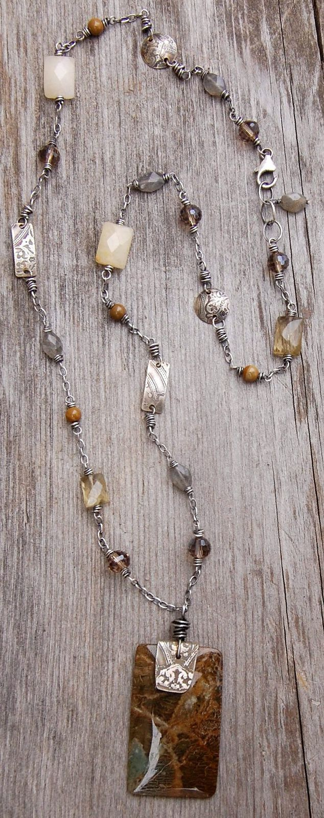 Necklace with glass beads and silver plaques.
