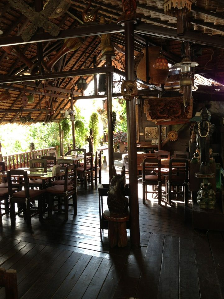 I don't think you can do much better than Natural Restaurant in Phuket Town. It's a rickety wooden, traditional Thai shack with an eclectic jumble of plants, waterfalls, fishponds and strange artifacts sprouting out from all corners, including fish tanks made out of old TV sets.  It has an extensive menu of Thai food, probably one of the best I have seen in Phuket and the prices are very reasonable.