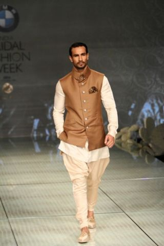 Tarun Tahiliani bridal fashion week 2014  Another pic of the brown with the unique collar