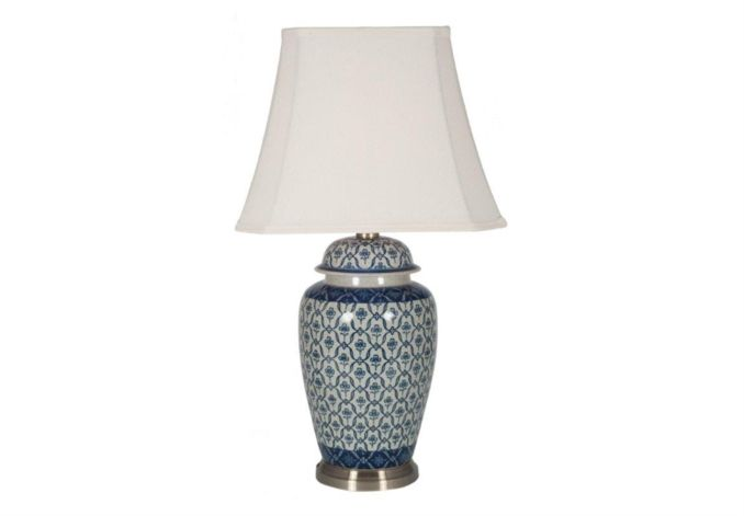 This classic ginger jar table lamp will add a touch of style to any room. The classic urn shaped porcelain base has a hand painted design in blue and cream, with brass fittings. A crisp white tapered shade completes the elegant look.