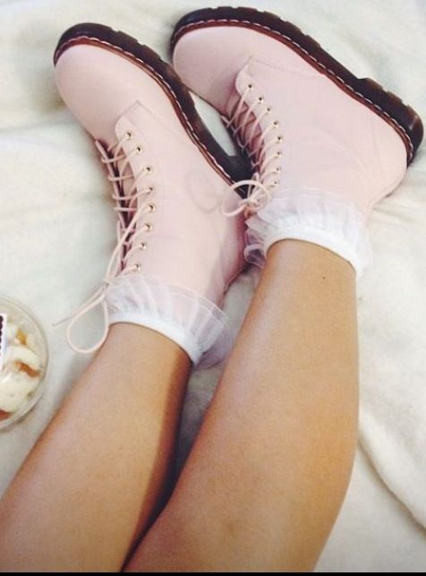 Pink combat boots with frilly socks