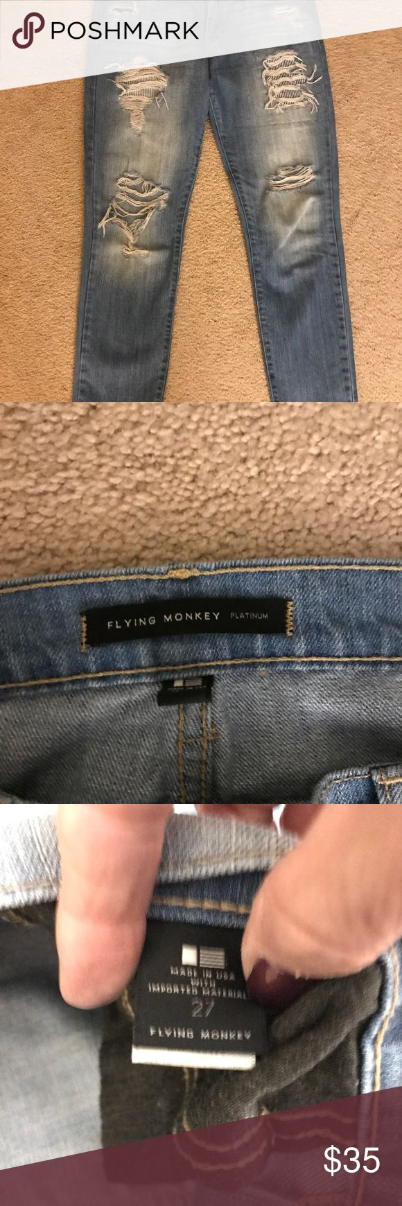 Flying Monkey Boyfriend Jeans, Size 27 Gently used pair of light washed Flying Monkey brand jeans in size 27.  They are a size 27, mid rise, lighter wash.  The upper  distressed areas have patches on the underside in a striped material and the lower distressed areas are open.  Length is to the ankles and they can be rolled up. Flying Monkey Jeans Boyfriend