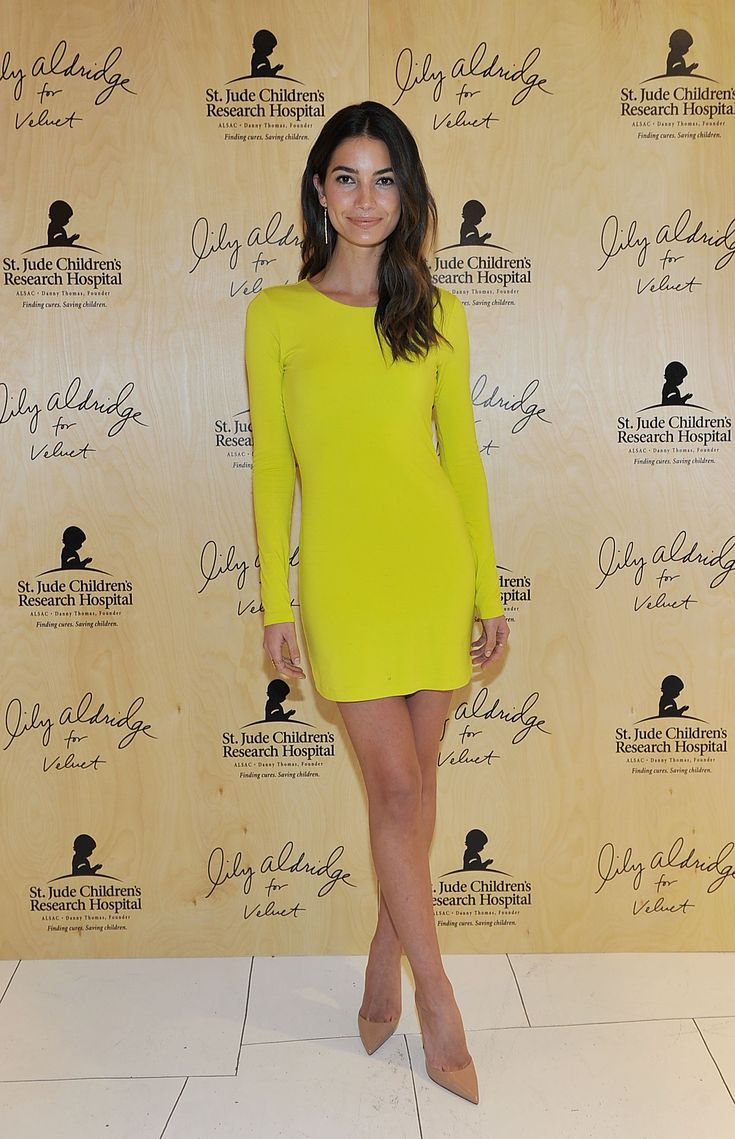 Lily Aldridge wearing a chartreuse long-sleeve mini dress and nude heels // #Model #Style