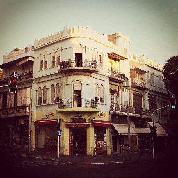 """The famous Allenby Street in Tel Aviv houses endless buildings from the """"Ecclectic Period"""".  Extremely charming and romantic designs demonstrating a period when the Europeans began to plant their seeds in the region.  They brought their own style and integrating it with the architectural charm of the East."""