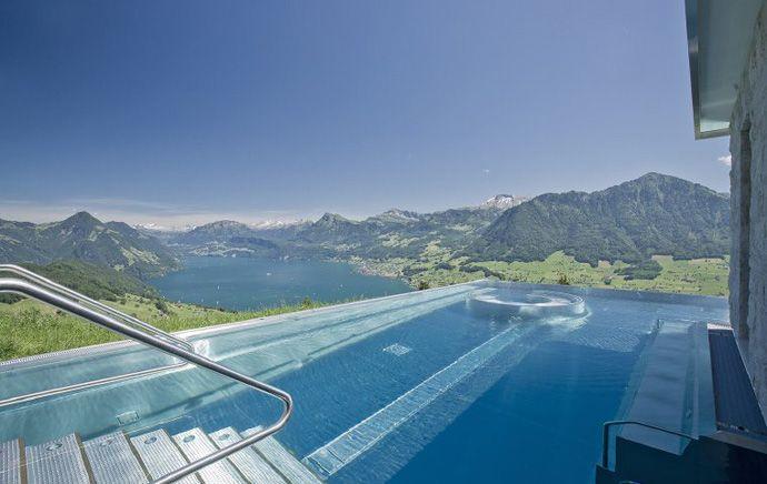 cool pool: edgeless endless pool on mtn view! 5-star Villa Honegg Luxury Hotel, on mount Bürgenstock, Lake Lucerne, Switzerland, 914m ask, historic building, 23 boutique rooms (via ArchitectureArtDesigns.com) 2