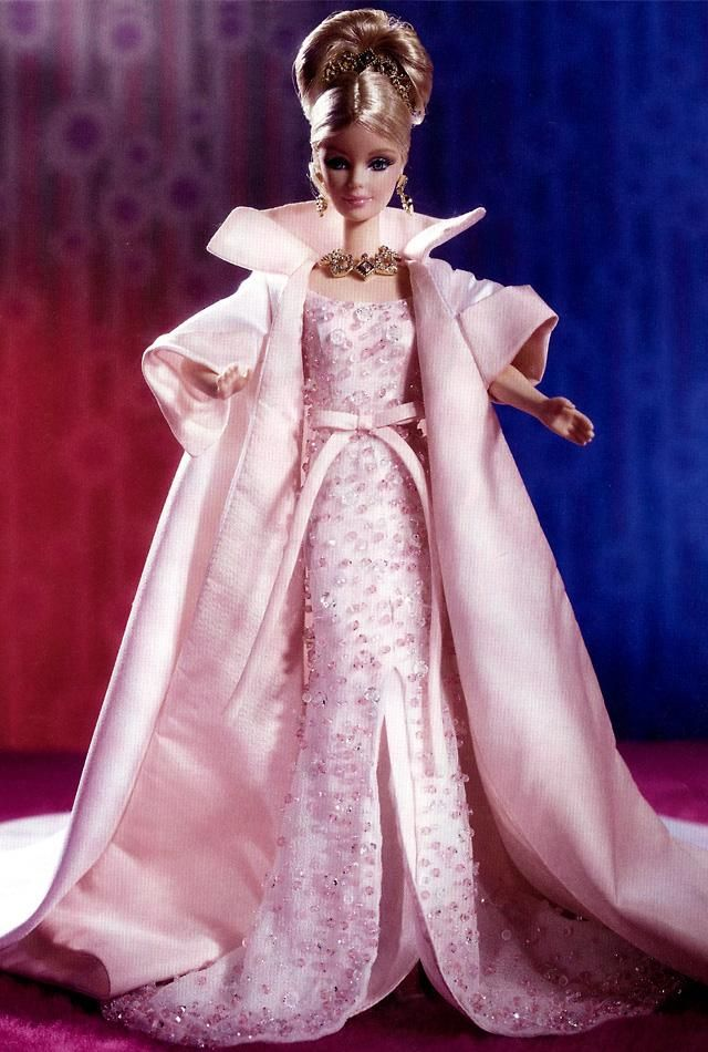 Limited Ed.   Released: 1/1/1999, 40th anniversary, Barbie® doll sparkles in this stunning ensemble. Her white chiffon gown is hand-beaded with dazzling Austrian crystals, and accented with a front slit and long train. Her fully-lined skirt has a pale pink satin bow tied at the waist, and her pink-lined opera coat has a train of white satin. Her blond hair is styled in an elegant upsweep, and accented with a glittering tiara of genuine diamonds.Was  through FAO Schwarz