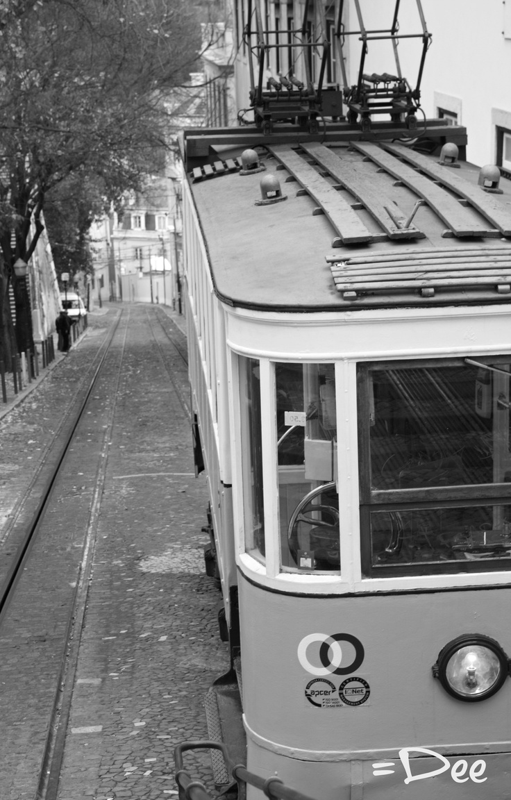 An old antique tram in the city of Lisbon