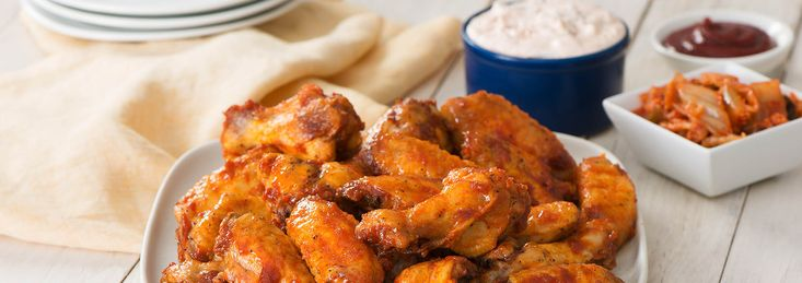 An abundance of umami flavours envelop these oven-crisp chicken wings and make their way into a fiery yet cool dipping sauce to seal in the experience.