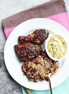 A simple oven roasted jerk chicken recipe along with coleslaw and rice & peas by The Sweet Escape.