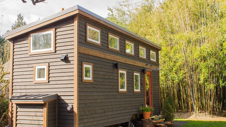 """The """"Hikari Box"""" tiny house—named after the Japanese word that means """"light-filled""""—may only be 184 square feet, but it's full of nifty features. Japanese-inspired storage stairs? Built-in bedside shelves? You got it."""