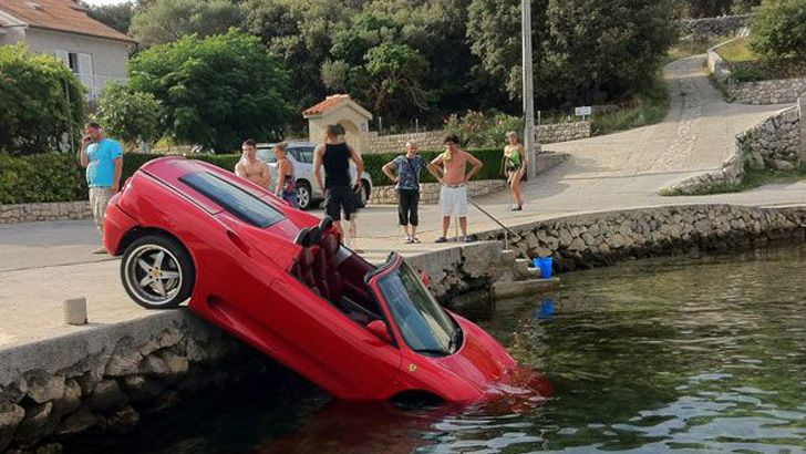 Ferrari crashes into local pond. ..aahhh oops