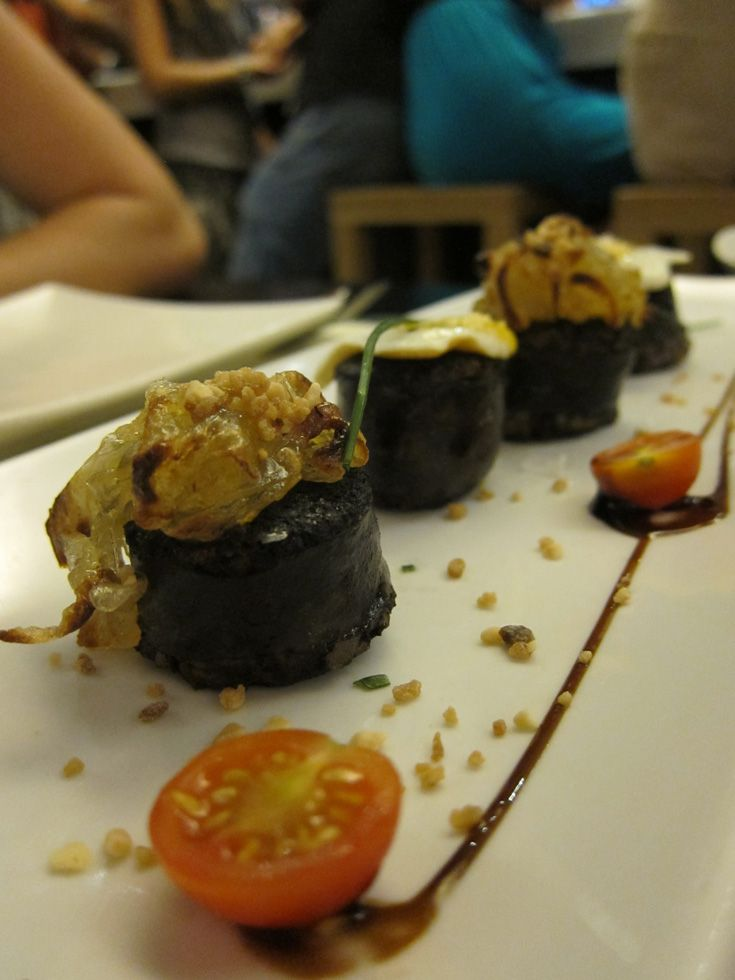 Revel & Roam is about trying great local food. Pictured here is a sampler of tapas in Spain.