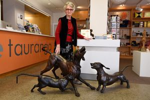 Hairy Maclary author Dame Lynley Dodd with three of the sculptures in the Hairy Maclary installation at Creative Tauranga. Photo/George Novak