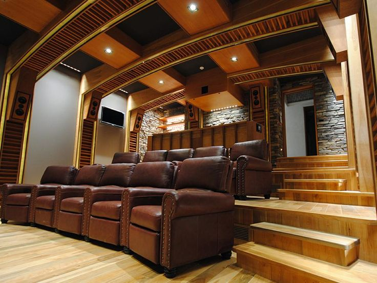 This Home Theater System Features Wood Architecture Detailed Ceiling Design Wood Floor A Bar Area Stone