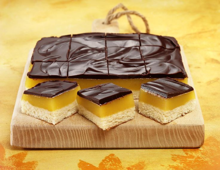 Chocolate orange jelly squares! A zingy treat incorporating a sponge layer, an orange jelly layer and an indulgent layer of dark chocolate to finish!.
